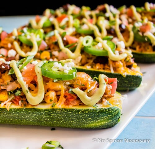 Tex-Mex Stuffed Zucchini Boats with Avocado Cilantro Crema