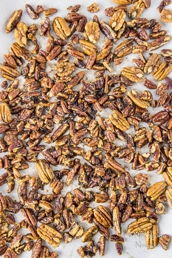 Overhead shot of buttered pecans on a piece of parchment paper - one of the main ingredients in No Churn Salted Caramel Ripple Butter Pecan Ice Cream recipe.