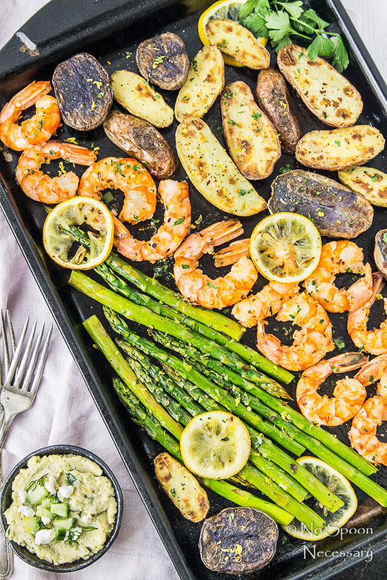 Sheet pan garlic lemon shrimp asparagus fingerling potatoes overhead shot of sheet pan garlic lemon shrimp with asparagus and fingerling potatoes garnished with forumfinder Choice Image