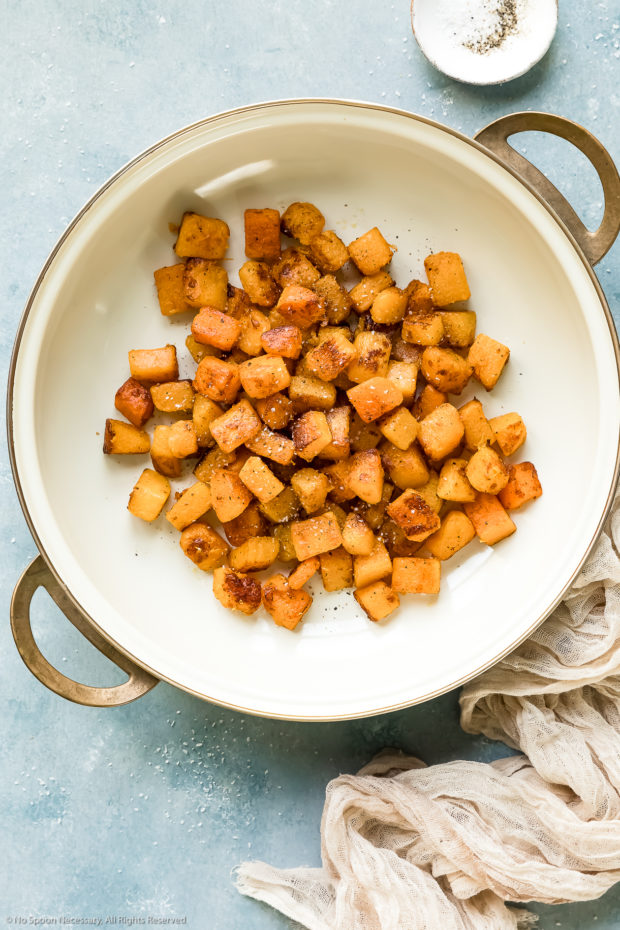 Overhead photo of sauteed, caramelized cubes of butternut squash pasta in a large skillet - photo of step 2 of the butternut squash pasta recipe.