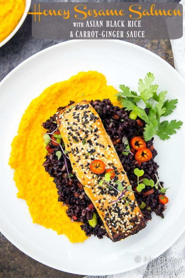 Overhead shot of Honey Sesame Salmon & Asian Black Rice Salad with carrot-ginger sauce on a white plate garnished with fresh cilantro.
