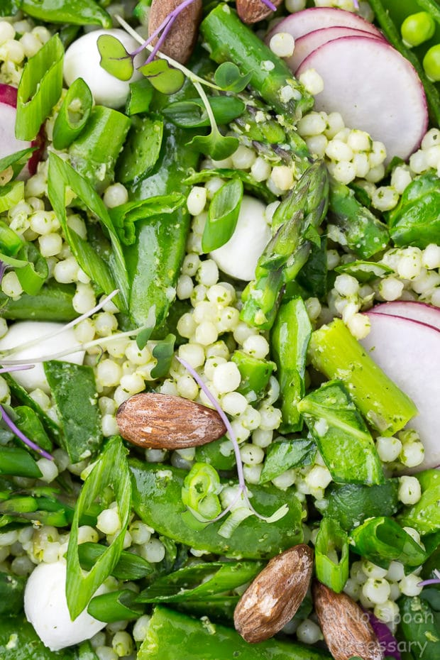 Overhead, up close shot of Glowing Green Spring Couscous Salad with Lemon Basil Pesto.