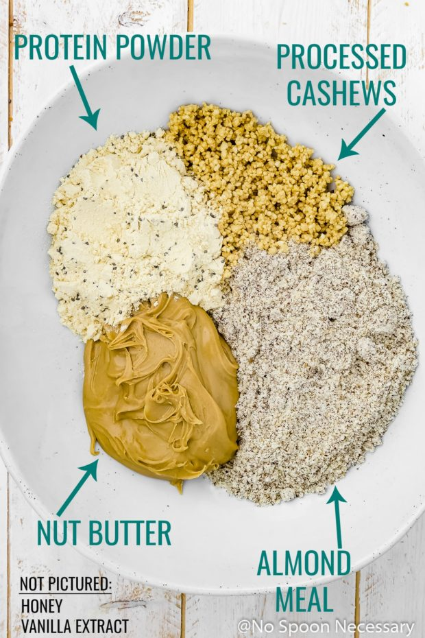 Overhead shot of all the ingredients needed to make No Bake Honey Nut Vanilla Protein Energy Bites neatly organized into a large bowl before mixing - photo of step 3 of the recipe.
