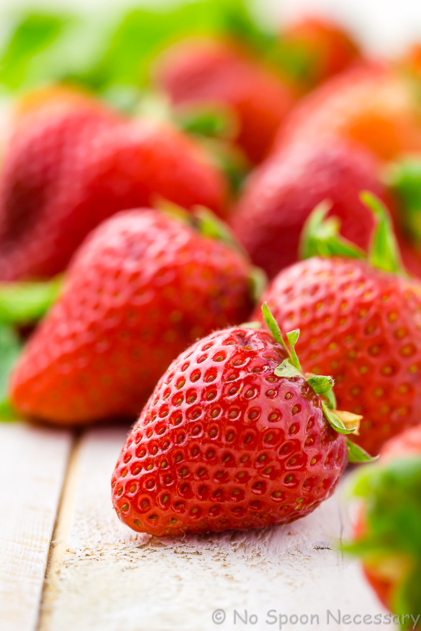 Angled, close up shot of fresh strawberries