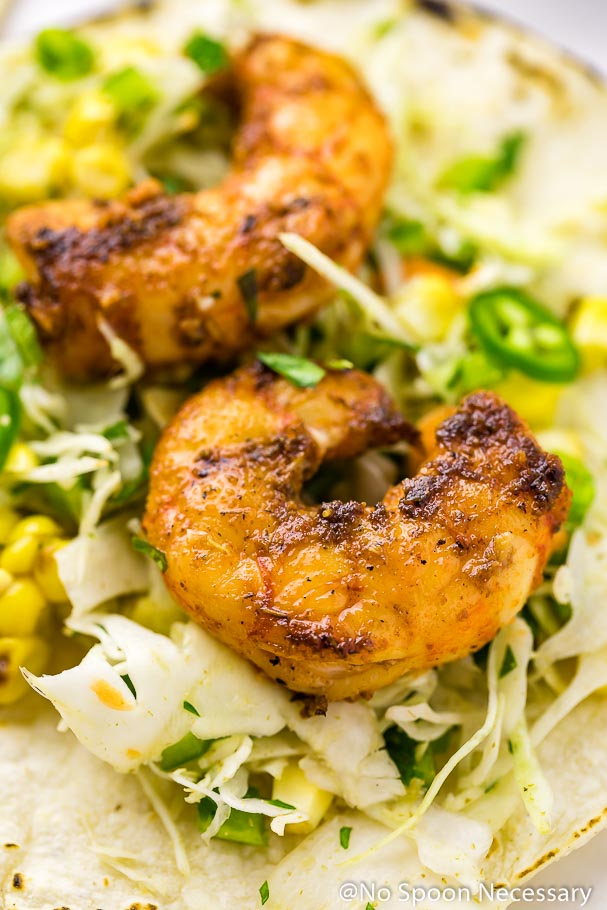 Angled up-close shot of a Cajun Shrimp Taco with spicy corn slaw.