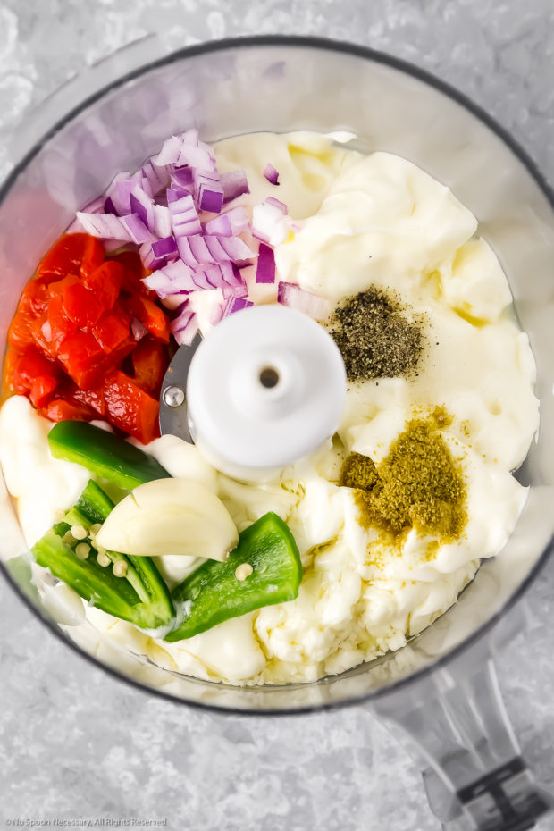 Overhead photo of all the ingredient for creamy Mexican sauce for Ceviche Tostadas in a food processor bowl.