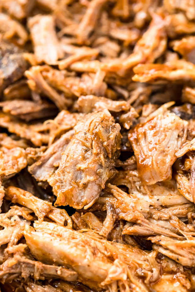 Angled, up close shot of a pile Slow Cooker Easy Carolina BBQ Pulled Pork.