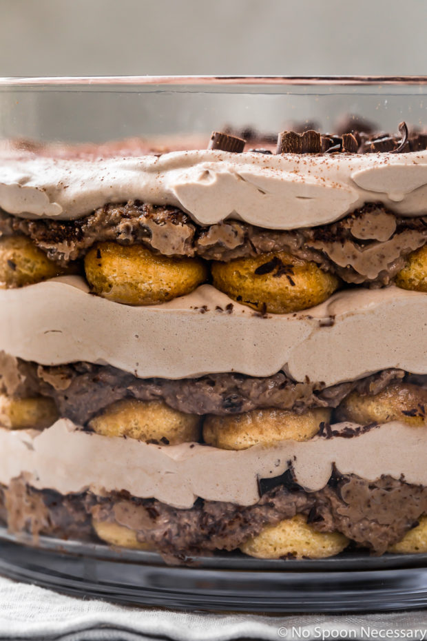 Straight on, up close shot of an Easy Chocolate Tiramisu Trifle on a pale blue linen.