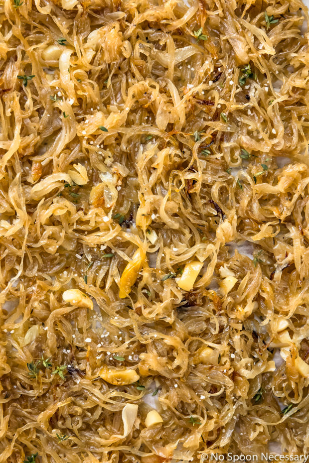 Overhead, up-close photo of Oven Caramelized Onions drizzled with Worcestershire sauce - photo of step 4 of the Oven Caramelized Onions Recipe.