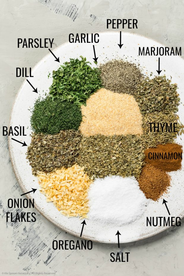 Overhead shot of all the ingredients needed to make Homemade Greek Seasoning Recipe with the name of each ingredient written out next to it.