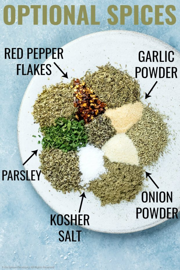 Overhead photo of optional ingredients in Italian seasoning neatly arranged on a plate with the name of each ingredient written out next to it.