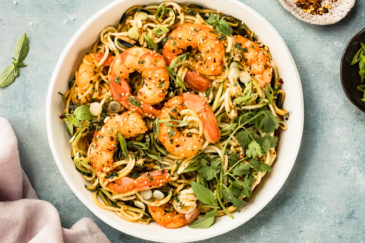 Overhead photo of Zucchini Vegetable Noodle Stir Fry with shrimp in a white serving bowl.