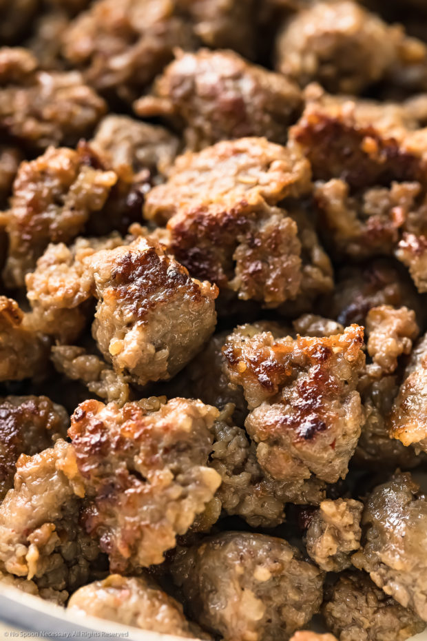 Angled, up close photo of browned, cooked Italian sausage crumbled - photo of the main ingredient in Italian sausage soup recipe.