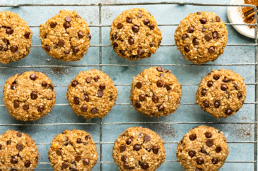 Overhead photo of healthy breakfast cookies on a large wire rack with a ramekin of cinnamon next to the rack.