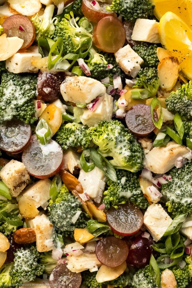Overhead, close-up photo of creamy broccoli grape salad with almonds.