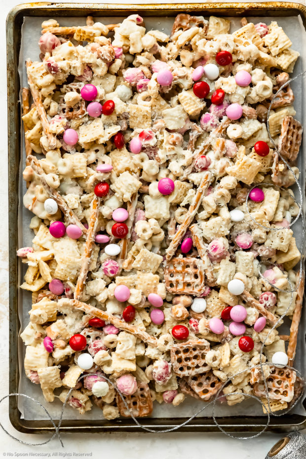 Overhead photo of Sweet Chex Mix on a parchment-paper lined sheet pan.