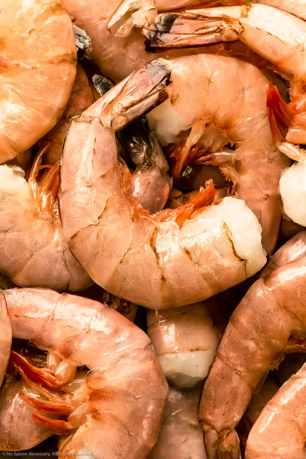 Overhead, close-up photo of fresh jumbo pink shrimp prior to peeling and deveining (photo of the main ingredient in the recipe)