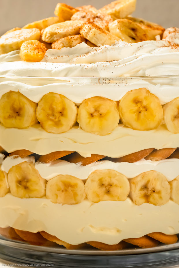 Straight on, close-up photo of Southern Banana Pudding layered in a large trifle dish.
