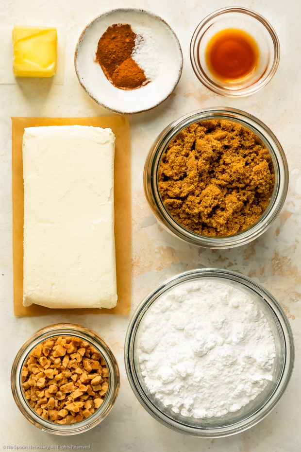 Overhead photo of all the ingredients needed to make cream cheese fruit dip neatly organized into individual bowls.